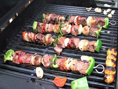meal(0.0), samgyeopsal(0.0), outdoor grill(1.0), grilling(1.0), barbecue(1.0), meat(1.0), churrasco food(1.0), food(1.0), dish(1.0), shashlik(1.0), kebab(1.0), cuisine(1.0), barbecue grill(1.0), cooking(1.0), skewer(1.0), grilled food(1.0),