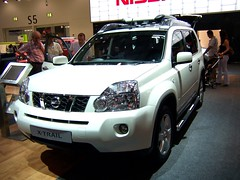 nissan xterra(0.0), nissan navara(0.0), automobile(1.0), automotive exterior(1.0), sport utility vehicle(1.0), vehicle(1.0), nissan x-trail(1.0), compact sport utility vehicle(1.0), crossover suv(1.0), nissan(1.0), bumper(1.0), land vehicle(1.0),