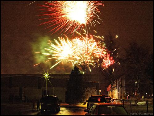 city cars rain night finland fireworks kokkola karleby