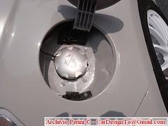 ceiling(0.0), steering wheel(0.0), mechanical fan(0.0), aircraft engine(0.0), automobile(1.0), automotive exterior(1.0), wheel(1.0), vehicle(1.0), light(1.0), rim(1.0), hubcap(1.0), spoke(1.0),