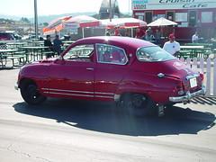 mid-size car(0.0), automobile(1.0), vehicle(1.0), automotive design(1.0), compact car(1.0), antique car(1.0), sedan(1.0), classic car(1.0), vintage car(1.0), saab 92(1.0), saab 96(1.0), land vehicle(1.0), motor vehicle(1.0),