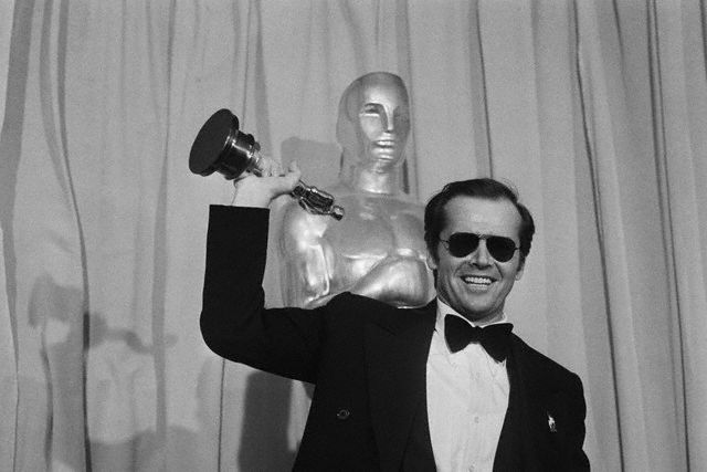 Jack Nicholson with the Oscar for best actor