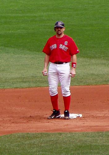 Holding his batting gloves