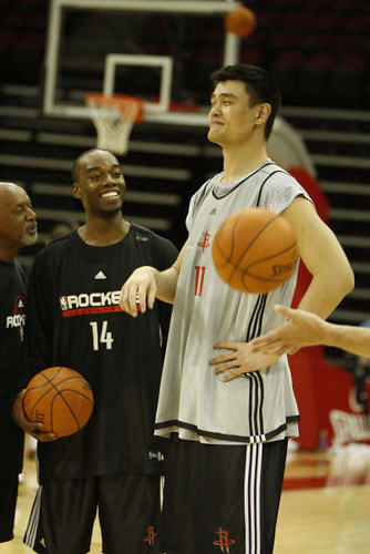 Sept. 30th - Yao Ming has a laugh with Carl Landry in Day 1 of Training Camp