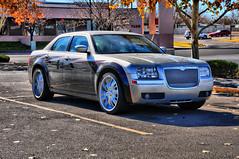 automobile(1.0), automotive exterior(1.0), wheel(1.0), vehicle(1.0), automotive design(1.0), chrysler 300(1.0), chrysler(1.0), sedan(1.0), land vehicle(1.0), luxury vehicle(1.0),