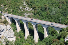 suspension bridge(0.0), rolling stock(0.0), overpass(0.0), track(0.0), devil's bridge(1.0), girder bridge(1.0), highway(1.0), aqueduct(1.0), transport(1.0), controlled-access highway(1.0), mountain pass(1.0), arch bridge(1.0), viaduct(1.0), bridge(1.0),