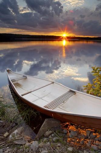 Canoe on a lake at sunset Nova Scotia Canada