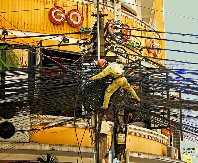 Saigon. Electrician at work