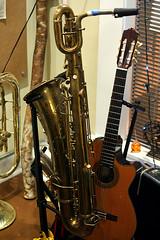 string instrument, musical instrument, baritone saxophone, guitar,