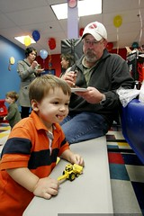 noa enjoying cake and a toy digger with his dad    M…