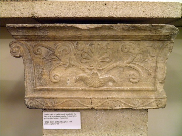 Finial of back of marble bench (exedra) in the form of a ionic pilaster-capital. An inscription on the return honours Apollonides, from the Temple of Athena Polias, Priene, British Museum