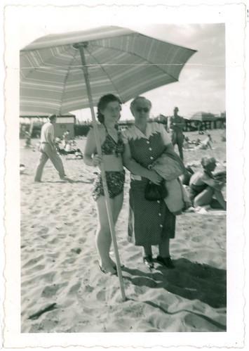 Two women beach umbrella