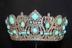 clothing(0.0), emerald(0.0), crown(1.0), jewellery(1.0), gemstone(1.0), headpiece(1.0), tiara(1.0), headgear(1.0),