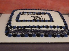 This 1/4 sheet cake was baked fresh to order.  The grad loved funfetti cake, so we made a 1/4 sheet cake, covered it in buttercream an added purple and black decorations.  Visit <a href='http://www.familysweetery.com' rel='nofollow'>www.familysweetery.com</a> for contact information.