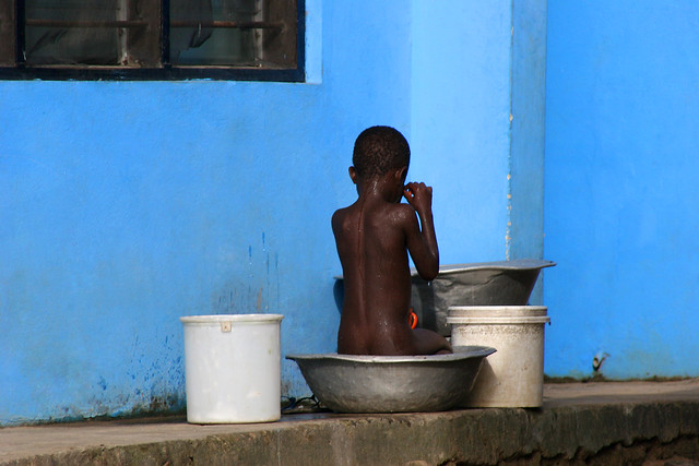 Boy and the blue wall in Ghana.