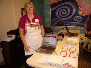Jean Montgomery, chatting about the MaintainIT Project in a classy apron!