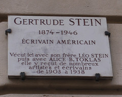 Photo of Gertrude Stein and Alice B. Toklas white plaque