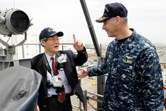 OSAKA, Japan (May 13, 2011) Capt. Daniel Grieco, commanding officer of 7th Fleet command ship USS Blue Ridge (LCC 19), speaks with the harbor pilot after pulling into Osaka, Japan. (U.S. Navy photo by Mass Communication Specialist Seaman James Norman)