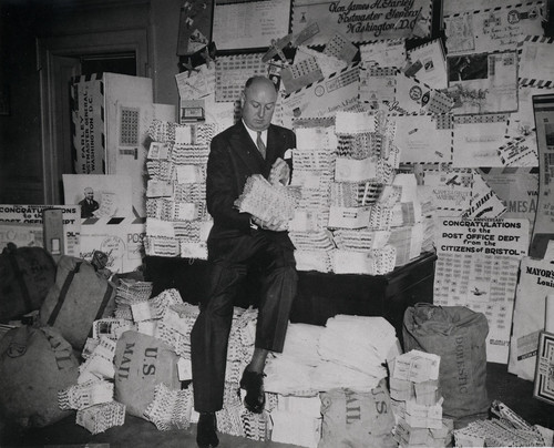 Man with loads and loads of letters, mostly airmail