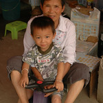Chinese Grandmother and Grandson - Xishuangbanna, China