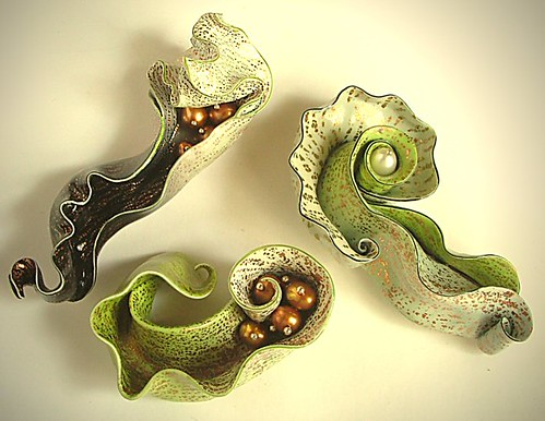 Trio of organic brooches