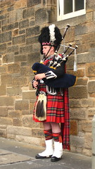 musician, clothing, red, kilt, costume, bagpipes, wind instrument,