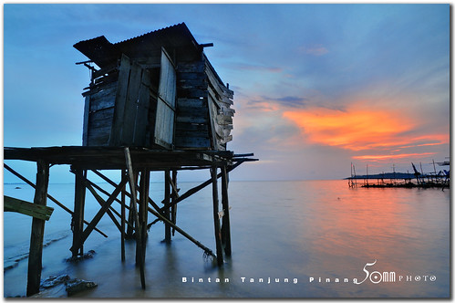sunset red sky indonesia island boat seaside fishing asia village jetty bintan tanjung pinang nikond300 fiftymm99 gettyimagesasia