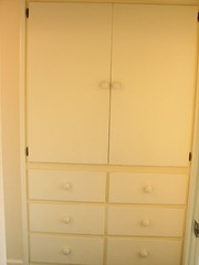 wardrobe(0.0), drawer(1.0), closet(1.0), furniture(1.0), chiffonier(1.0), cupboard(1.0), chest of drawers(1.0), chest(1.0), cabinetry(1.0),