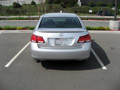 wheel(0.0), rim(0.0), mercedes-benz e-class(0.0), automobile(1.0), automotive exterior(1.0), executive car(1.0), vehicle(1.0), sports sedan(1.0), lexus(1.0), mid-size car(1.0), lexus gs(1.0), bumper(1.0), sedan(1.0), land vehicle(1.0), luxury vehicle(1.0), vehicle registration plate(1.0),