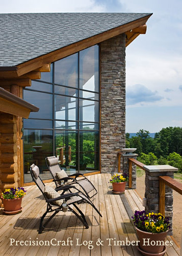 Custom log home deck exterior view by precisioncraft for Log home decks