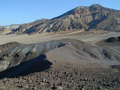 moraine(0.0), snow(0.0), volcanic crater(0.0), plateau(0.0), volcanic landform(0.0), mountain(1.0), tundra(1.0), mountain range(1.0), hill(1.0), summit(1.0), geology(1.0), ridge(1.0), natural environment(1.0), fell(1.0), landscape(1.0), wilderness(1.0), shield volcano(1.0), badlands(1.0), mountainous landforms(1.0),