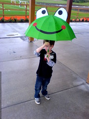 nick found a frog umbrella on the field   DSC00655