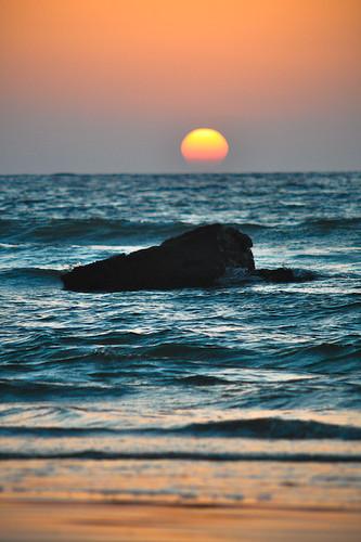 blue pakistan sunset sea sky orange sun beach water rock evening seaside karachi tones flickrmeet waterscape mubarakvillage