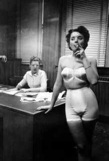 Stanley Kubrick: Lingerie model smoking in an office, Chicago, 1949