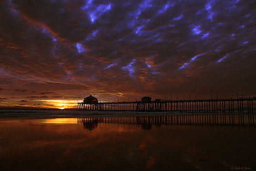california sunset usa reflection silhouette landscape geotagged photography smithsonian photo photocontest huntingtonbeach stormclouds smithsonianchannel aerialamerica