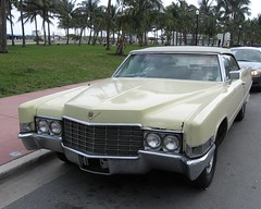 cadillac calais(0.0), full-size car(0.0), automobile(1.0), automotive exterior(1.0), cadillac(1.0), vehicle(1.0), cadillac eldorado(1.0), sedan(1.0), land vehicle(1.0), luxury vehicle(1.0),