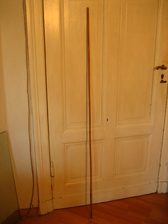 Bamboo pole against door