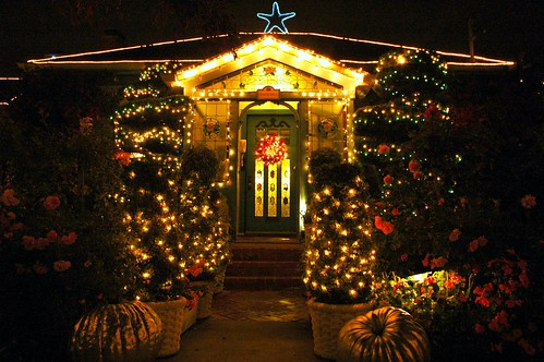 Pumpkins, fairy lights, flowers, topiary, blue star, wreath, front door, at entrance of the Mill Rose Inn, Half Moon Bay, California, USA by Wonderlane