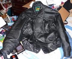 textile(1.0), leather jacket(1.0), clothing(1.0), leather(1.0), outerwear(1.0), jacket(1.0),