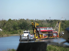 asphalt(0.0), ferry(0.0), tugboat(0.0), machine(1.0), vehicle(1.0), transport(1.0), river(1.0), dredging(1.0), canal(1.0), boat(1.0), waterway(1.0),