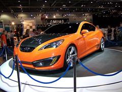 automobile(1.0), automotive exterior(1.0), exhibition(1.0), hyundai(1.0), wheel(1.0), vehicle(1.0), performance car(1.0), automotive design(1.0), auto show(1.0), hyundai genesis coupe(1.0), bumper(1.0), sedan(1.0), land vehicle(1.0), coupã©(1.0), sports car(1.0),