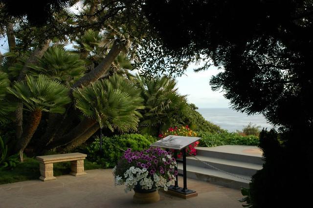 Dedication Plaque Near The Ocean Flowers Trees Bench Meditation Garden Self Realization