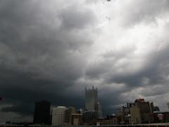 storm(0.0), thunder(0.0), thunderstorm(0.0), horizon(1.0), cumulus(1.0), cloud(1.0), cityscape(1.0), daytime(1.0), skyline(1.0), sky(1.0), dusk(1.0),