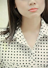 pattern, neck, face, hairstyle, clothing, lip, polka dot, outerwear, hair, fashion, long hair, brown hair, design, pink, beauty,