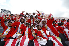 marching band(0.0), musician(0.0), marching(0.0), carnival(1.0), people(1.0), cheering(1.0), crowd(1.0),