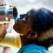 Thirsty woman drinking water - India