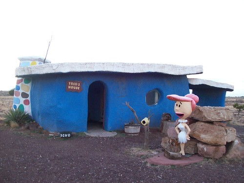 Wilma Flintstone standing in front of Fred's House in the fading sunlight at the tourist trap of Bedrock City, Arizona (bedrock32xy)