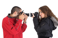 Professional looking pictures, Young man and woman taking pictures of each other