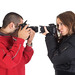 Young man and woman taking pictures of each other by ralphbijker