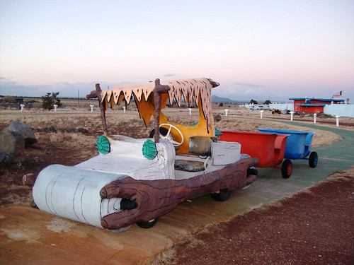 All Aboard!  Flintstones' car and carts at the tourist trap of Bedrock City, AZ (bedrock48xy)